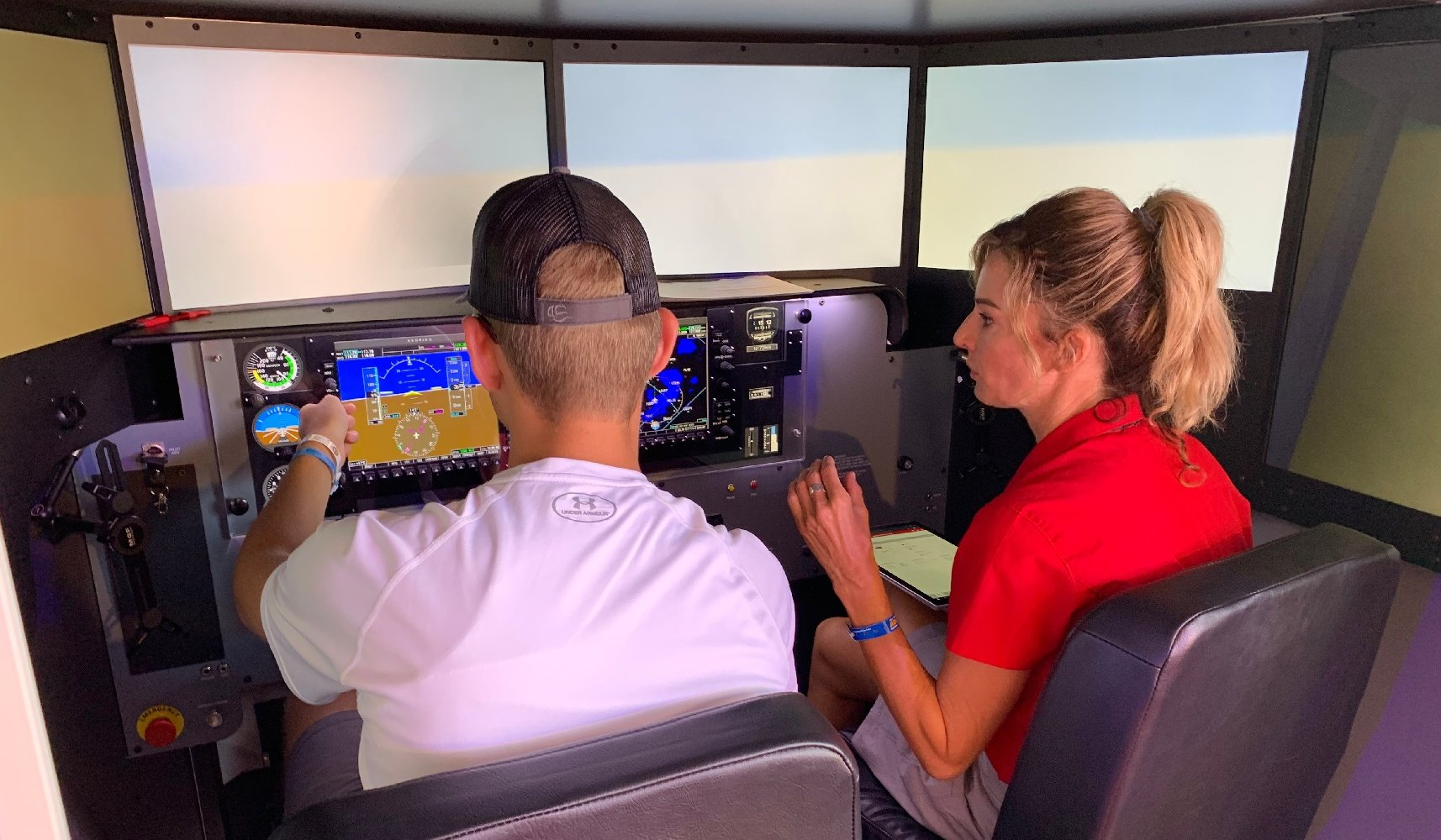 Student and Instructor in Redbird Simulator